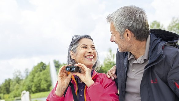 Elderly people with binoculars -